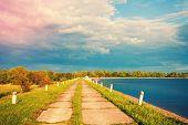 Embankment along the lake beautiful at sunset poster