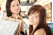 Two Shopping Women in shopping mal. poster