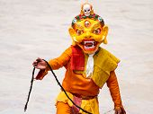 Unidentified monk performs a religious masked and costumed mystery dance of Tibetan Buddhism during the Cham Dance Festival on June 29 2012 in Hemis monastery India. poster