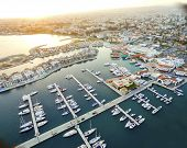 Aerial view of the beautiful Marina in Limassol city in Cyprus,beach,boats,piers,villas and commercial area.A modern,high end,newly developed space with docked yachts and for a waterfront promenade. poster