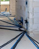 Pipes and heating system at house construction site. floor heating system the collector and tools poster