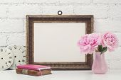 feminine mock-up with vintage frame and pink flowers on a white desk poster