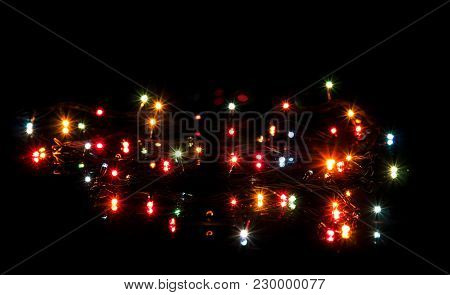 Glittering Lights Christmas Garland Isolated On Black Background