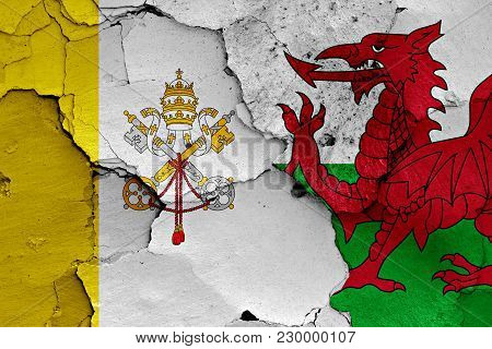 Flag Of Vatican And Wales Painted On Cracked Wall