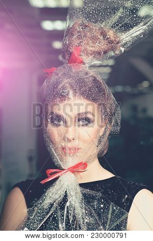 Girl With Transparent Wrapper On Face, Present. Woman Face Makeup Wrapped In Overwrap, Pack. Beauty,