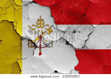 Flag Of Vatican And Austria Painted On Cracked Wall