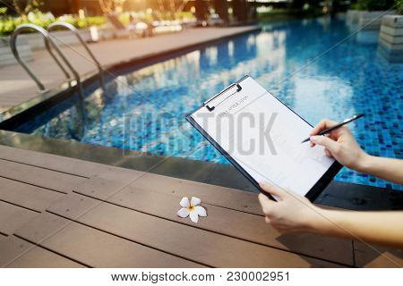 Beautiful Young Girl Is Filling Out Visa Application Form, Focus On Document. Concept Of Travel With