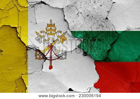 Flag Of Vatican And Bulgaria Painted On Cracked Wall