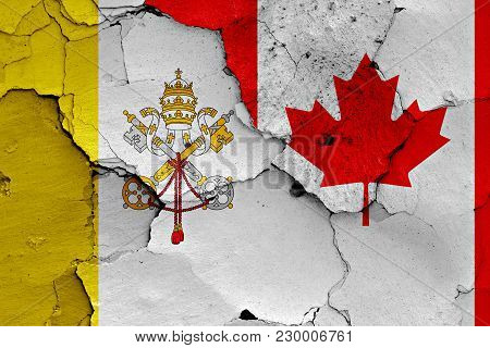 Flag Of Vatican And Canada Painted On Cracked Wall