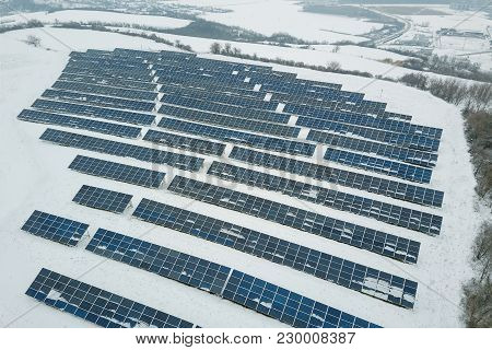 Solar Panel Field With Snow On Panels
