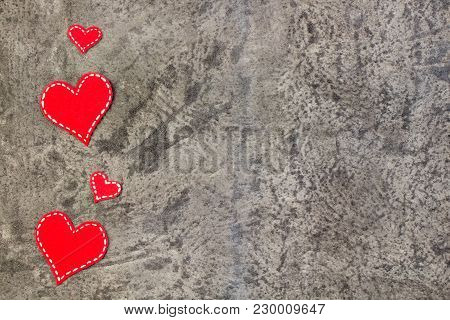 Red Hearts On Gray Concrete Background. Copy Space. Top View.