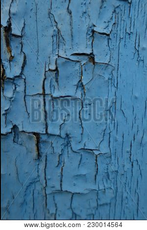 Closeup Of Peeling Paint On Old Blue Wooden Wall