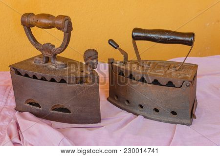 Two Old Irons  Made Of Cast-iron   On A Shirt /two Old Irons  Made Of Cast-iron   On A Shirt
