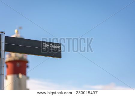 City Centre Sign With Plymouth Lighthouse In The Background