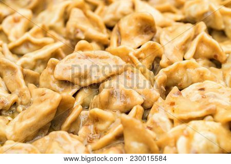 Close Up Of Dumplings Stuffed With Veal Meat Or Pelmeni. Traditional Russian Cuisine.
