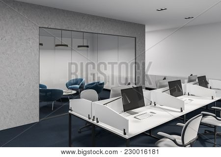 White And Concrete Office Cubicles With Computer Desks Inside. White Office Chairs And Large Windows