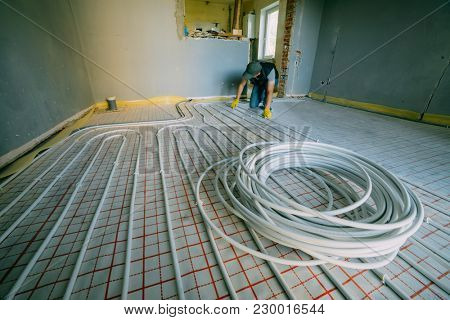 Pipefitter installing system of heating. Repair in the apartment