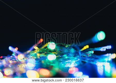 Abstract blurred christmas ligth background. Defocused celebration glowing texture