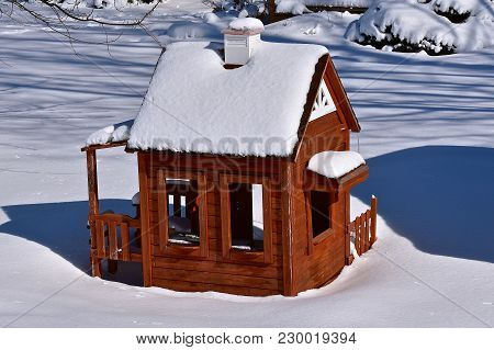 A Child Playhouse Is Covered With Snow During The Winter Season