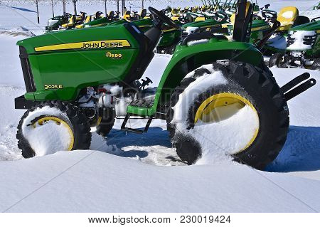 Moorhead, Minnesota, March 5, 2018:  The 3025e John Deere Tractor  Covered With Snow Is A Product Of