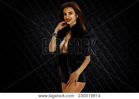 Young Beautiful Girl In Frenzy Black Bodysuit With Bare-breasted Isolated On White Background