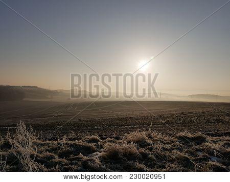 Sunrise On A Misty Frosty Morning Over A Field