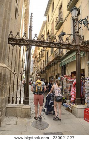 Granada, Spain - May 21, 2017: People In Narrow Street Next To The Cathedral In The Old Town Of Gran