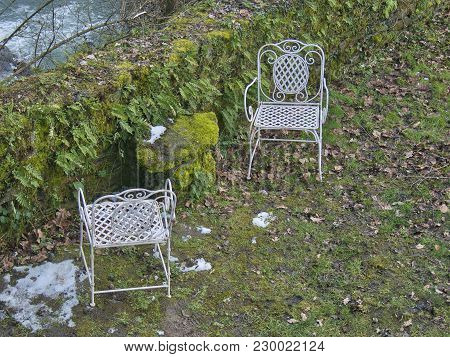Abandoned Chairs In A Meadow In A Garden In Autumn