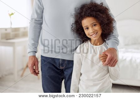 My Loving Dad. Attractive Alert Curly-haired Girl Smiling And Standing Near Her Dad And Her Dad Hold