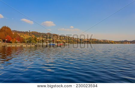 View Of The Lake Of Viverone In Italy With The Dock For Mooring Boats /lake Viverone Is The Third La