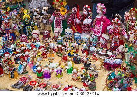 Handmade Ethnic Rag-dolls In The Shop-window On Fair. Traditional Colorful Dolls. Diy
