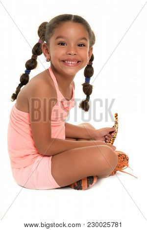 Funny african american girlsitting on the fllor and smiling  - Isolated on white
