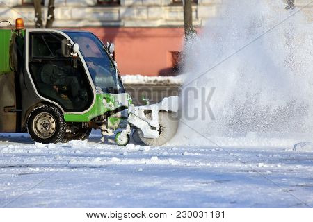 Street Cleaning The City From Snow With The Help Of Special Machinery
