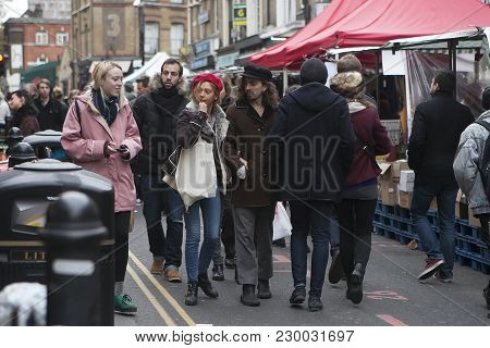 London, Uk - April 22, 2016: Girl In Red Beret And Man With Long Hair In Black Hat Dressed In Cool L