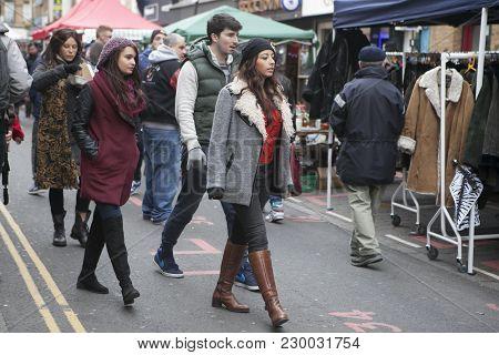 London, Uk - April 22, 2016: The Hipster Girls Dressed In Cool Londoner Style Walking In Brick Lane,
