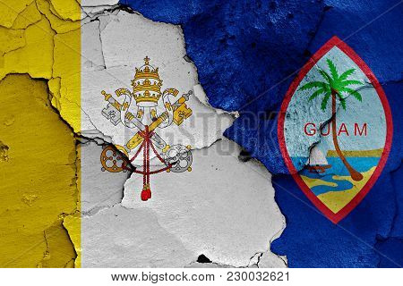 Flag Of Vatican And Guam Painted On Cracked Wall