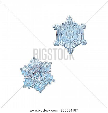 Two Snowflakes Isolated On White Background. Macro Photo Of Real Snow Crystals: Small Star Plates Wi