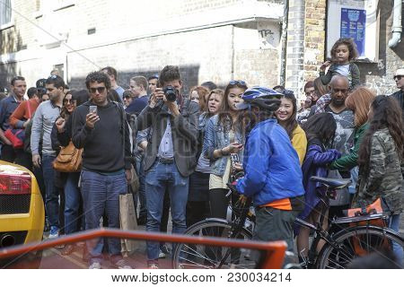 London, England - July 12, 2016 The Crowd Taking Pictures Famous Actor Riding By In The Car At Brick