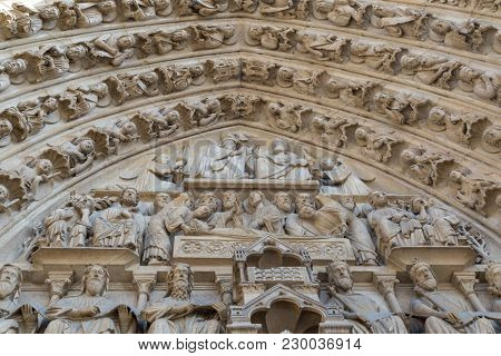 Paris, France - famous Notre Dame cathedral facade saint statues. UNESCO World Heritage Site