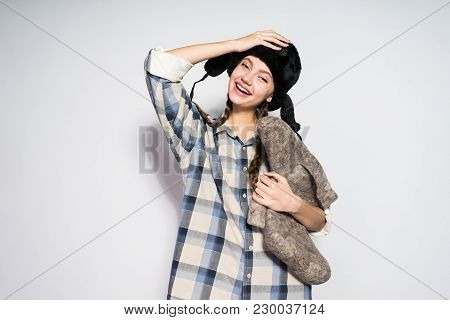 Happy Young Russian Girl Holding Gray Felt Boots In Hands