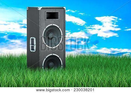 Concert Loudspeaker In Green Grass Against Blue Sky, 3d Rendering