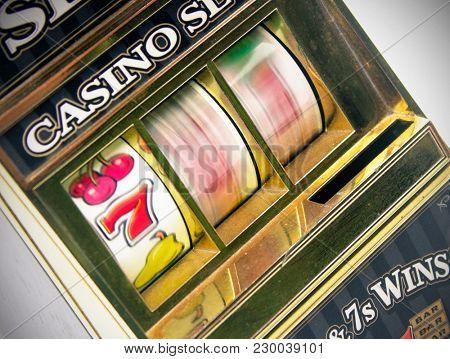 retro toy slot machine spinning to win