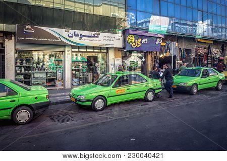 Tehran, Iran - October 15, 2016: Green Cabs On A Street Of Tehran City