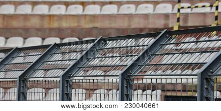 Robust Metal Fence In The Stadium To Split The Fans
