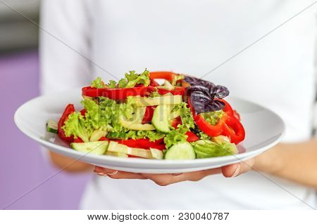 Vegetable Salad Of Tomatoes, Pepper, Lettuce, Cucumber And Basil. The Concept Is Healthy Food, Diet,