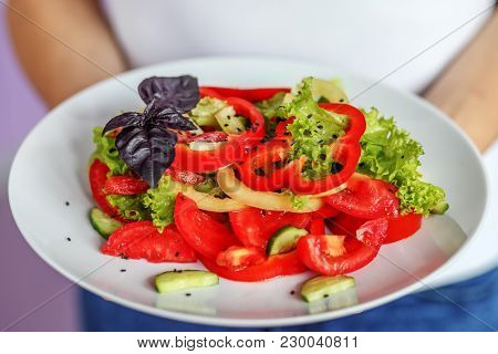 Vegetable Salad Of Tomatoes, Pepper, Lettuce And Sesame Salad. The Concept Is Healthy Food, Diet, Ve