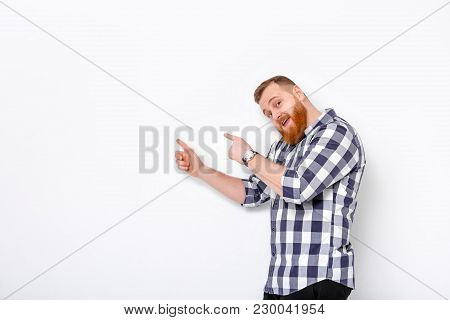 Handsome Man With Beard Pointing Copy Space. Smiling Man In Plaid Shirt Looking At Camera And Pointi