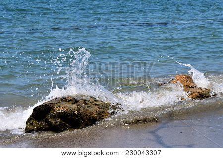 Caribbean Sea Smashing Against Rocks On The Beach