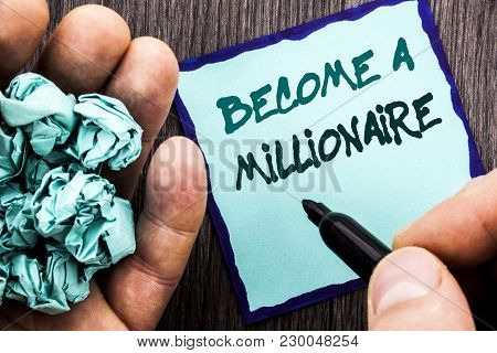 Announcement text showing Become A Millionaire. Business concept for Ambition To Become Wealthy Earn Fortune Fortunate written Notebook Book Man Writing Holding Pen wooden background. poster