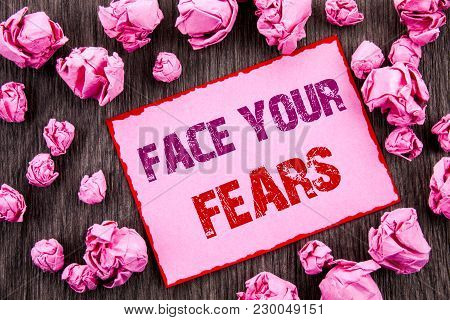 Handwriting Text Showing Face Your Fears. Business Photo Showcasing Challenge Fear Fourage Confidenc
